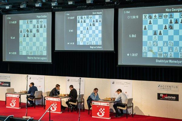 Les six joueurs du tournoi de Grands-Maîtres sur la scène (Photo: Simon Bohnenblust / Biel Chess Festival).