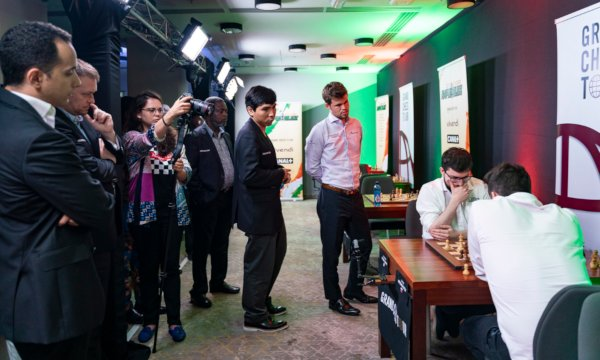 End of the very last game against Nepo, under the watchful eyes of Carlsen and Wesley So (Photo: Leenart Ootes).