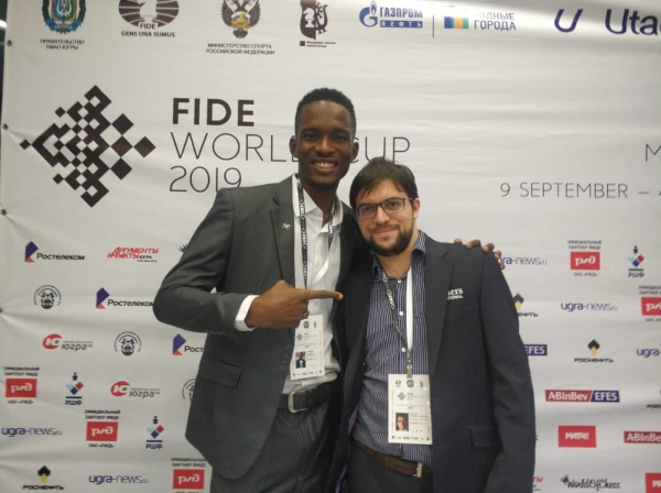 Proud to have lost after a creditable performance, Nigerian Daniel Anwuli poses with his winner.